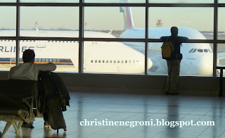 passengers+at+window+to+airplanes.JPG