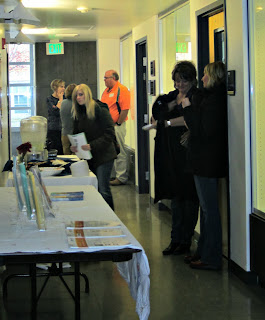 Participants gathered at the AT Lab to check out AAC devices.