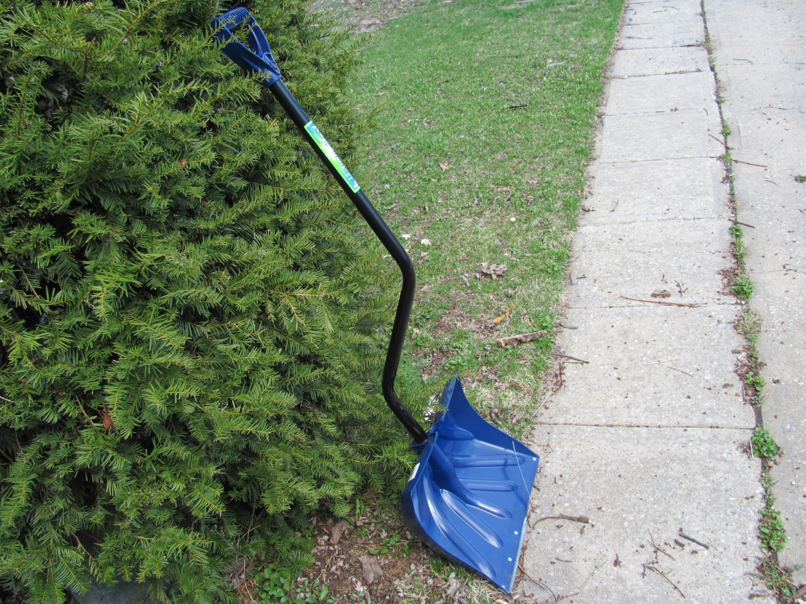 Blue snow shovel on display before being sold on Craigslist
