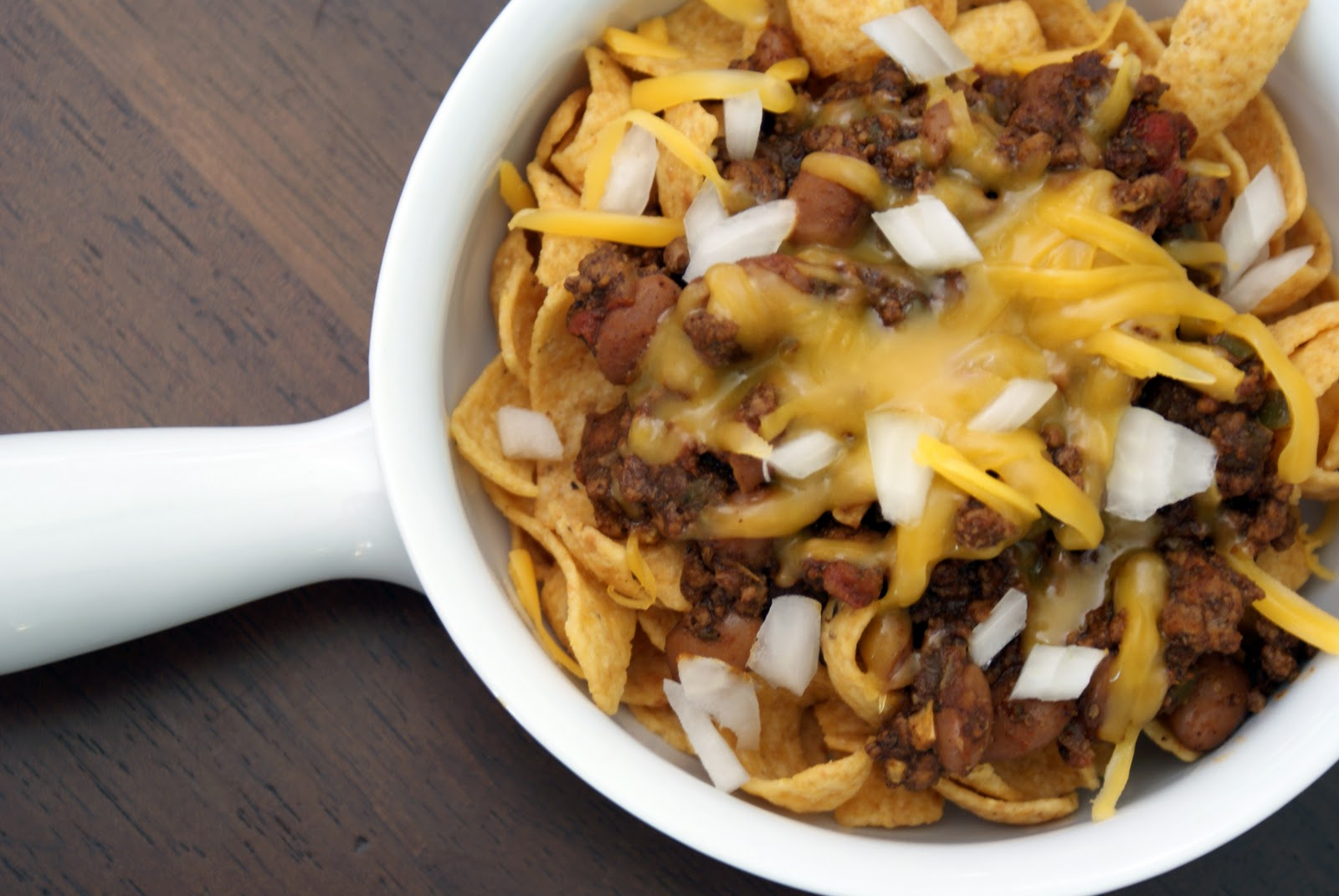 The classic Frito pie is this: a single-serving bag of Fritos, opened ...