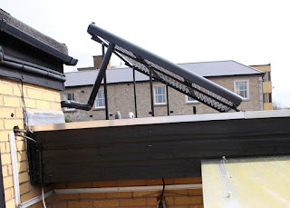 Solar thermal tubes located on roof showing supports
