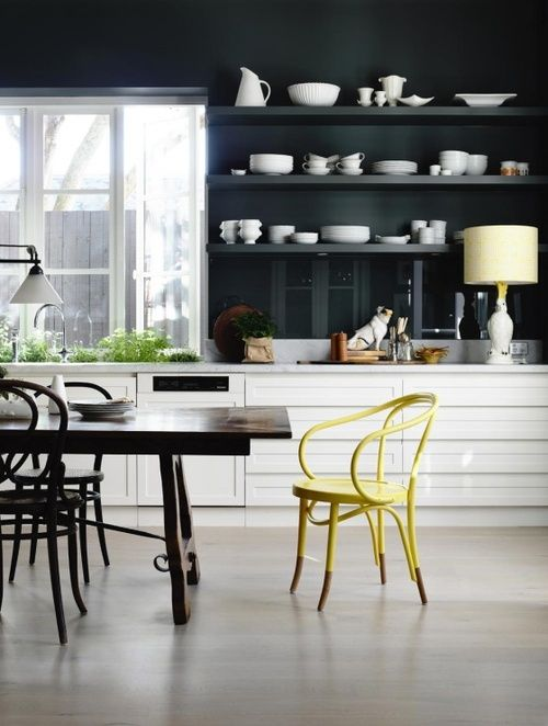 modern black and white kitchen with yellow chair