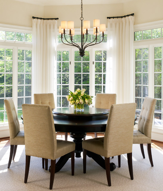 Innovative Iron Chandelier in the Dining Room with Round Dining Tables and Brown Chairs near Glass Windows