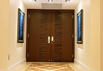 beautiful wood textured door in this lovely foyer with abstract painting
