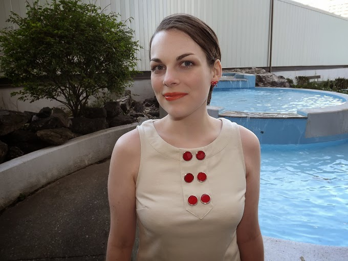 Forever 21 red mod buttons dress, LimeCrime lipstick, Lime Crime My Beautiful Rocket modeled, orange lipstick worn, slicked pixie hair, Victoria Park Place Fountain, Windsor Ontario fashion blogger, Windsor style blog, Suzanne Amlin, A Coin For the Well