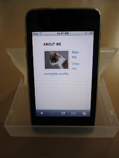 [this blog displayed on iPod in portrait orientation in plastic tape cartridge case]