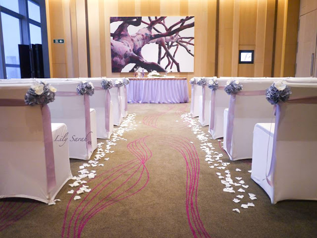 Ceremony aisle decoration with vintage purple bouquets