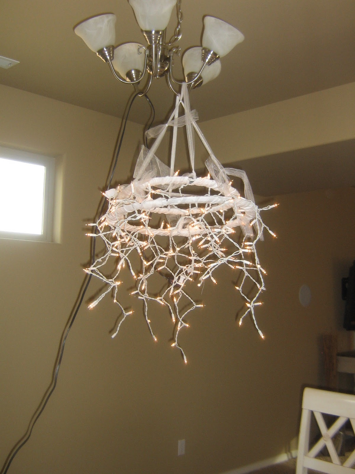 Home is where they love you: Christmas Light Chandelier