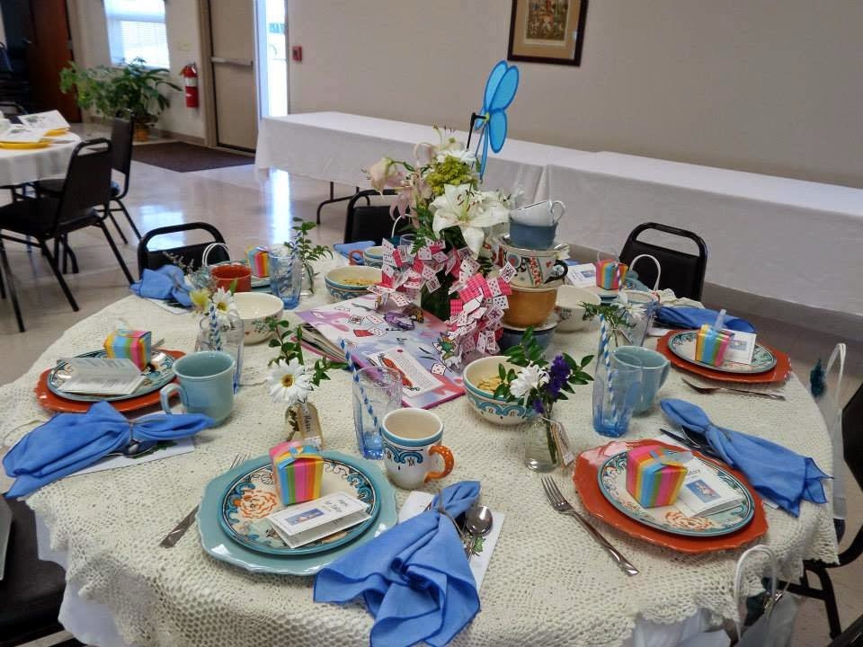 Alice\u0027s table featured a mix-matched table setting but with coordinated dishes in a blue burnt orange and taupe. The plates had a scroll design while the ... & McBookwords - Blog: Lunching with Peter (Rabbit) and Alice (in ...