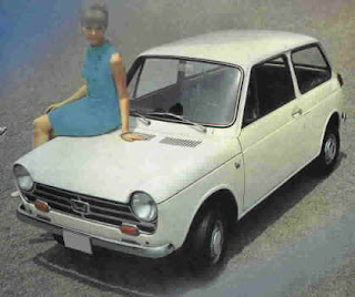 White Honda 600 Coupe, with lady on hood.