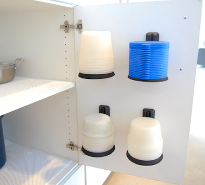 nesting and stacking food storage containers, mounted on a cabinet door