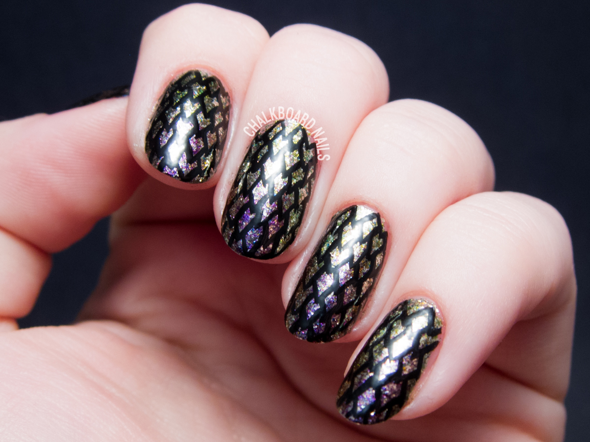 Freehand dragon scale nail art by @chalkboardnails
