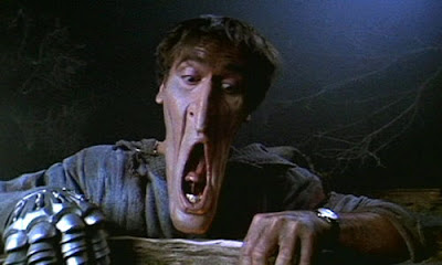 Bruce Campbell getting his face stretched in Army of Darkness