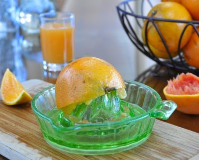 Juicing oranges for fresh-squeezed orange juice.