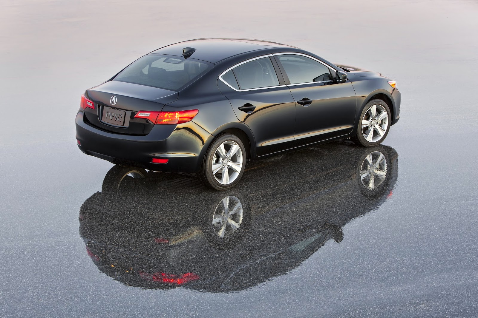 Rear 3/4 view of 2014 Acura ILX Premium