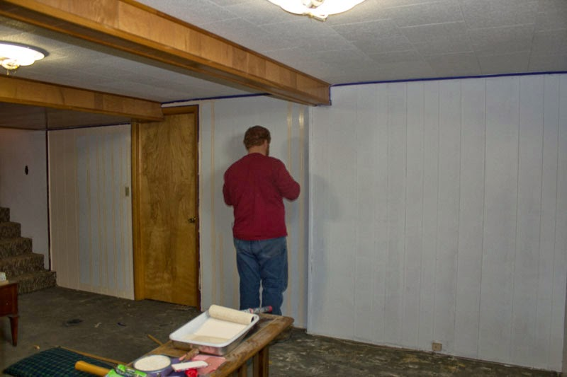 Redbeard painted some of the valleys of the wood paneling & Snapshots of a Kansas Farm: Transformation Tuesday: Basement Wall ...