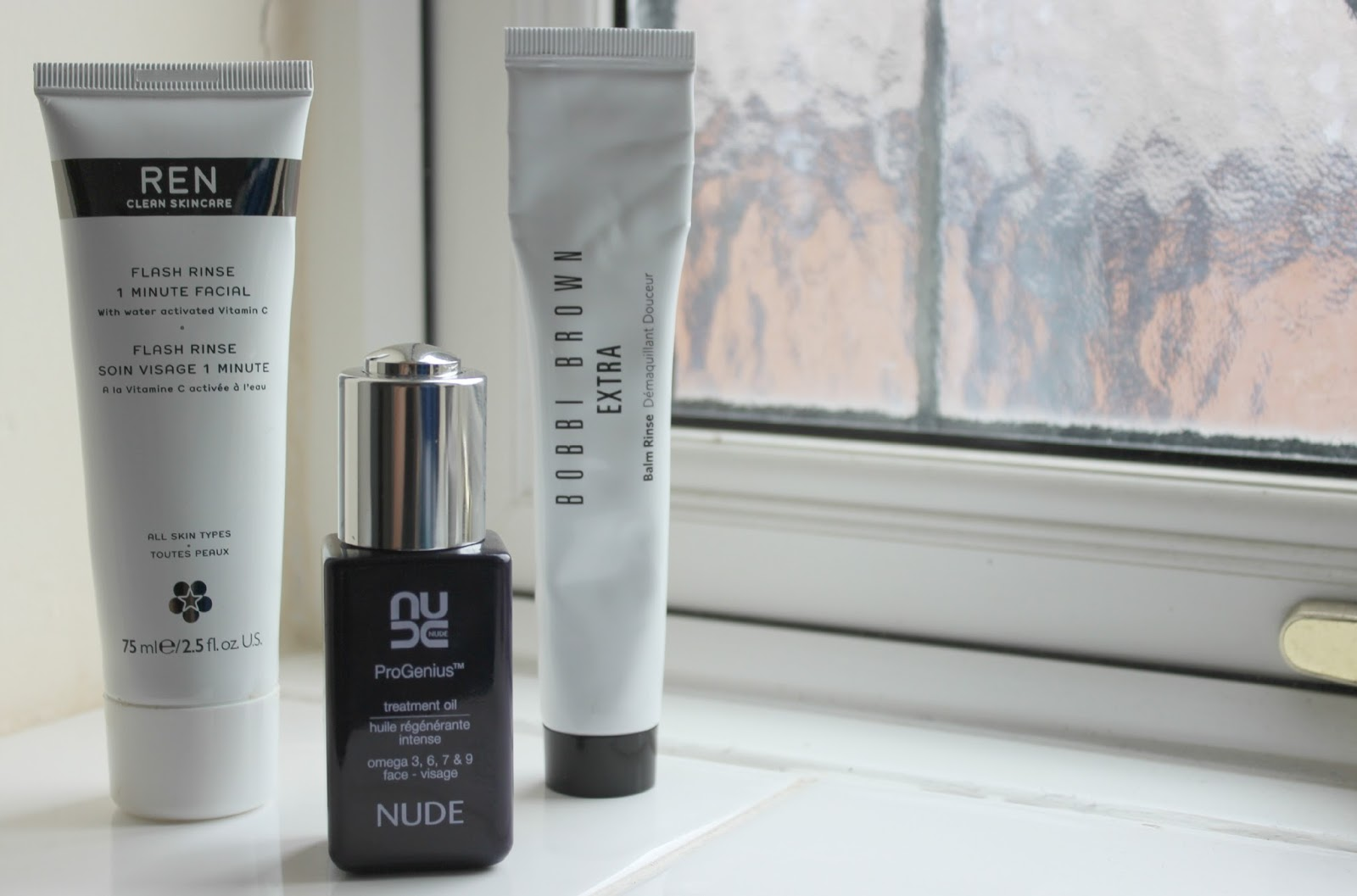 A picture of the Bobbi Brown Extra Balm Rinse To-Go, Nude ProGenius Omega Treatment Oil and REN Flash Rinse 1 Minute Facial