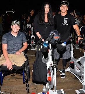 Cher with a couple of the soldiers