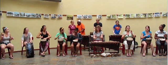 Drumming session at Gugu's Thebe Arts & Cultural Centre in Langa. Front row, Brandi, Kristin, ?, Maria, Brittany, Becky, Theresa, Sam, Erica. Back row), Kelsey, teacher, Michael, Mackenzi.