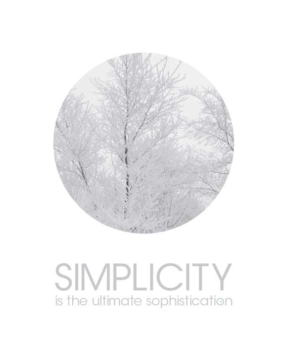 circle with frost covered trees text simplicity is the ultimate sophistication