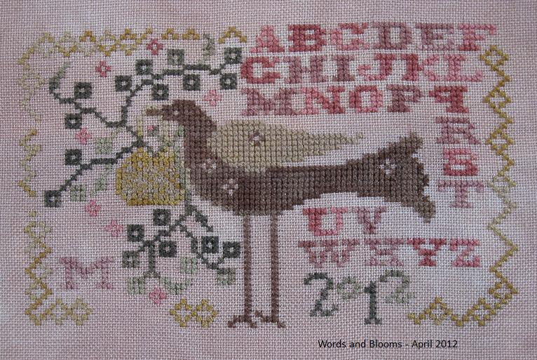 Words and blooms stitching to keep the wolves at bay for Christmas garden blackbird designs