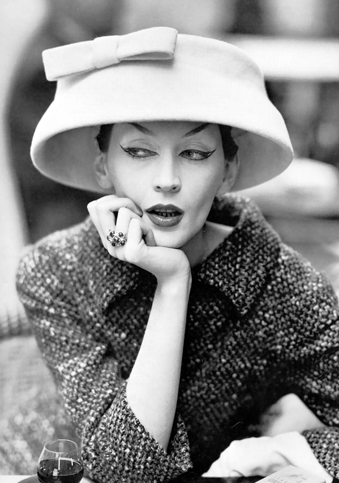 Dovima in chloche & suit by Balenciaga, Dafe Des Deux Magots, Paris, August 1955, photographed by Richard Avedon