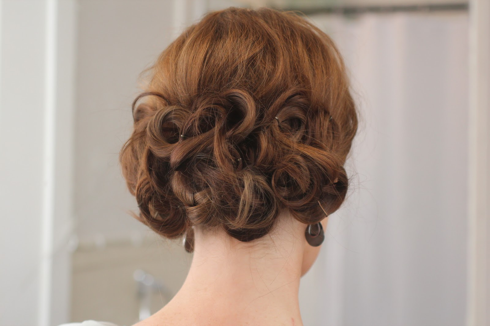 How to Style a Loopy Low Updo
