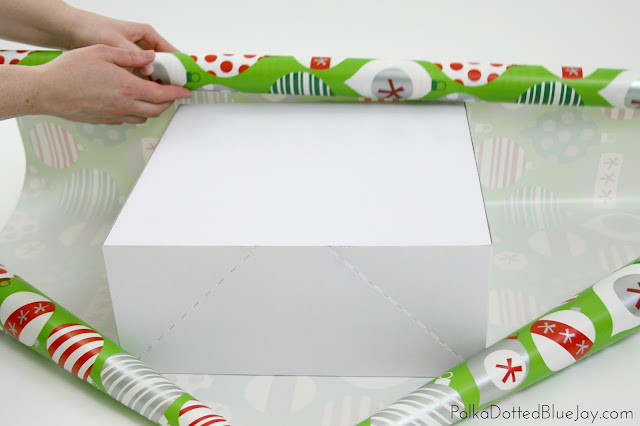 An easy and quick tutorial on how to wrap beautiful Christmas presents! Click through to see how easy it is to wrap department store quality Christmas gifts like a pro! #BIGSeason #BigLots #CollectiveBias #ad