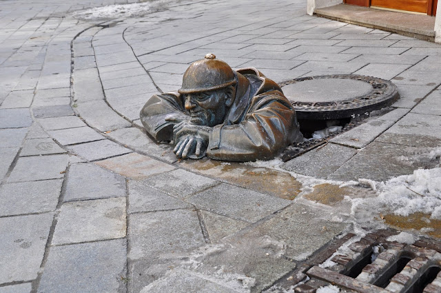 Statue of a Man Peeping out of a Manhole in Bratislava