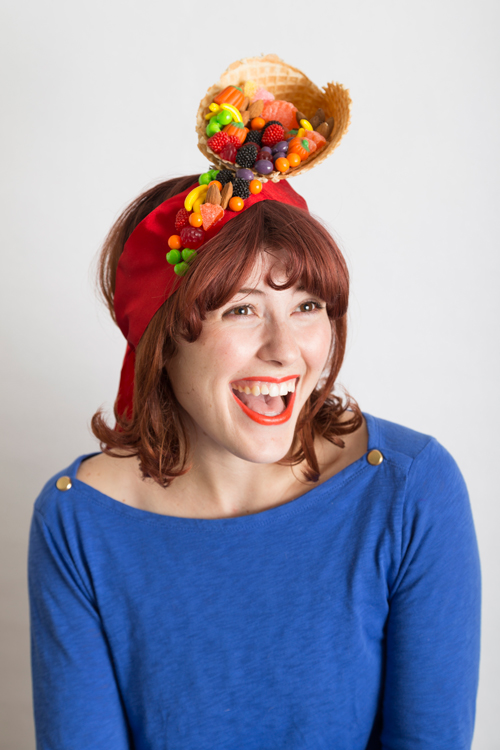 Start a new tradition of making hats for each other to wear on Thanksgiving like this candy cornucopia fascinator.