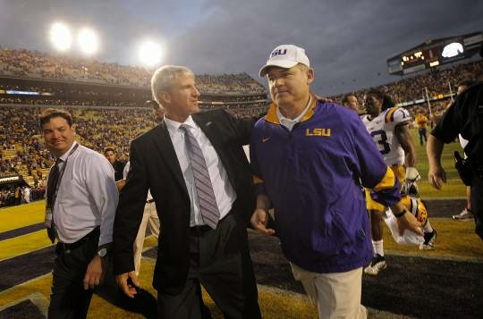 Les Miles and LSU AD Joe Aleva show displeasure with new SEC scheduling plan.