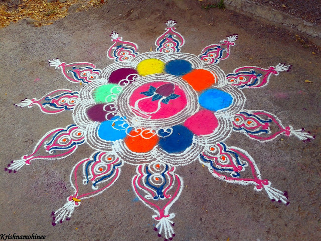 Image: Rangoli by different auspicious symbols with different colors
