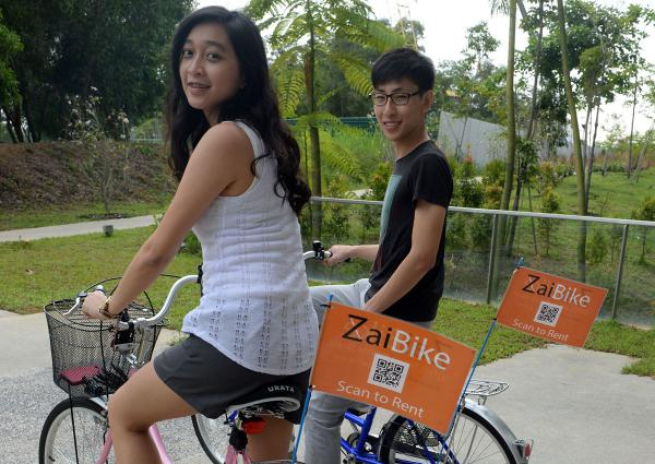 Zaibike's fleet manager Chok Xin Lin (left), 21, and its CEO Lee Jun Xiang, 23, riding on campus on two of their nine bicycles available for rent.
