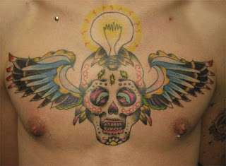 Skull with Wings Tattoo Design on Male Chest