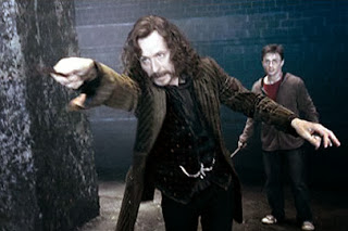 Sirius Black pushing Harry back