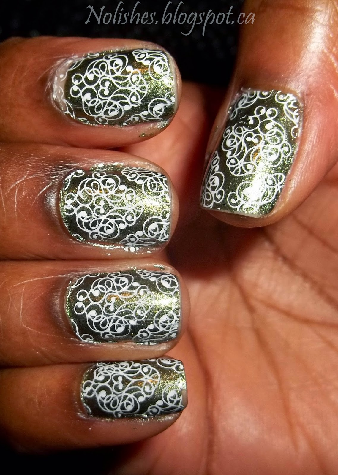 Green and White Nail Stamping Manicure using Sinful Colors 'Vintage', and Konad Special Polish in White. Stamped using full nail filigree pattern image from Lily Anna Plate 10.