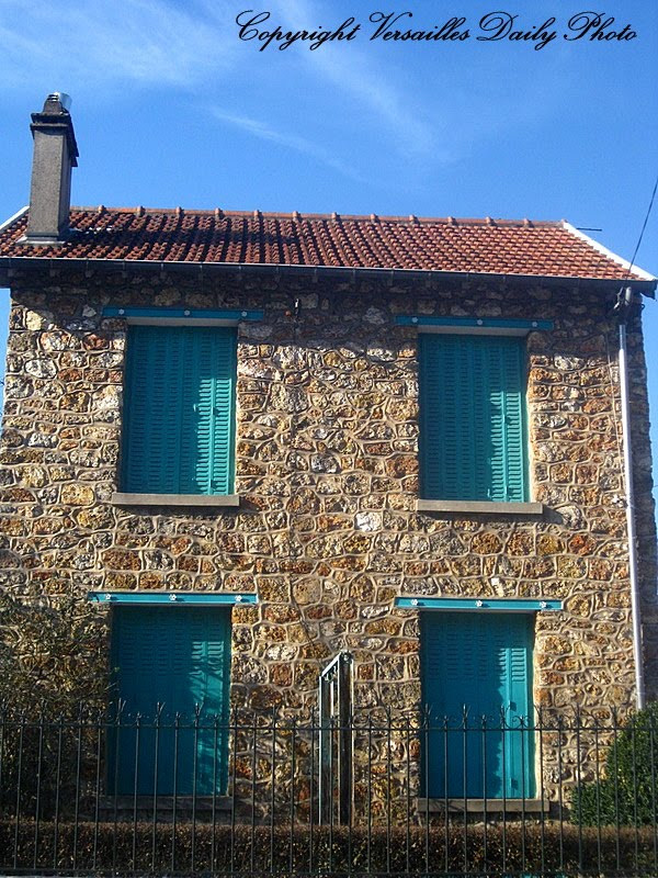 turquoise shutters in porchefontaine neighbourhood