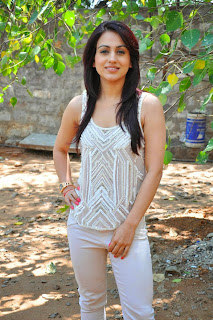 Actress Aksha Pardasany Latest Pictures in White Jeans at Dr Saleem Success Meet 014