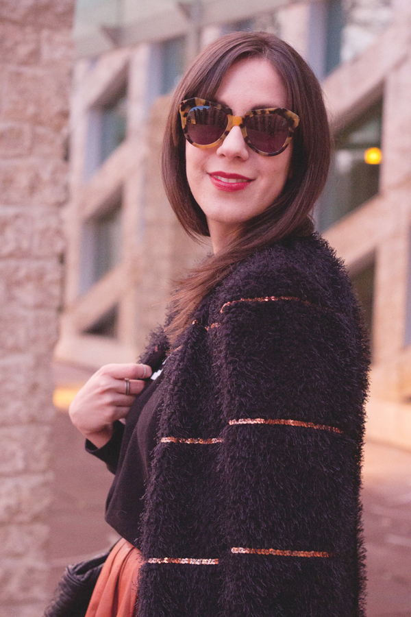 Mixing a furry statement coat with sequins and Karen Walker sunglasses