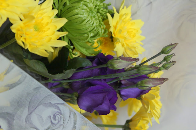 close up shot of yellow purple and white flower bouquet