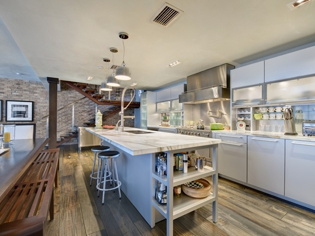 Modern kitchen and the staircase at South Pointe Modern Apartment, Miami Beach, Florida