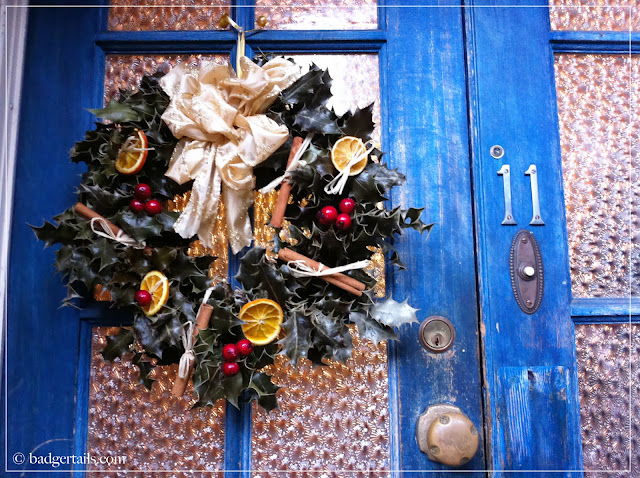 Hand Decorated Holly Christmas Wreath Hanging on Door