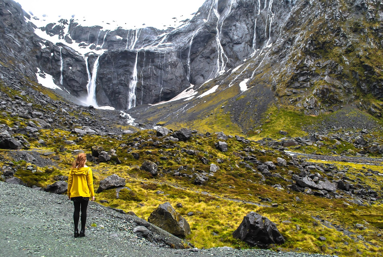 Watching waterfalls at the Fjordland National Park on the Southern Explorer Topdeck tour.