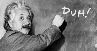 Albert Einstein writing 'Duh!' on a chalkboard