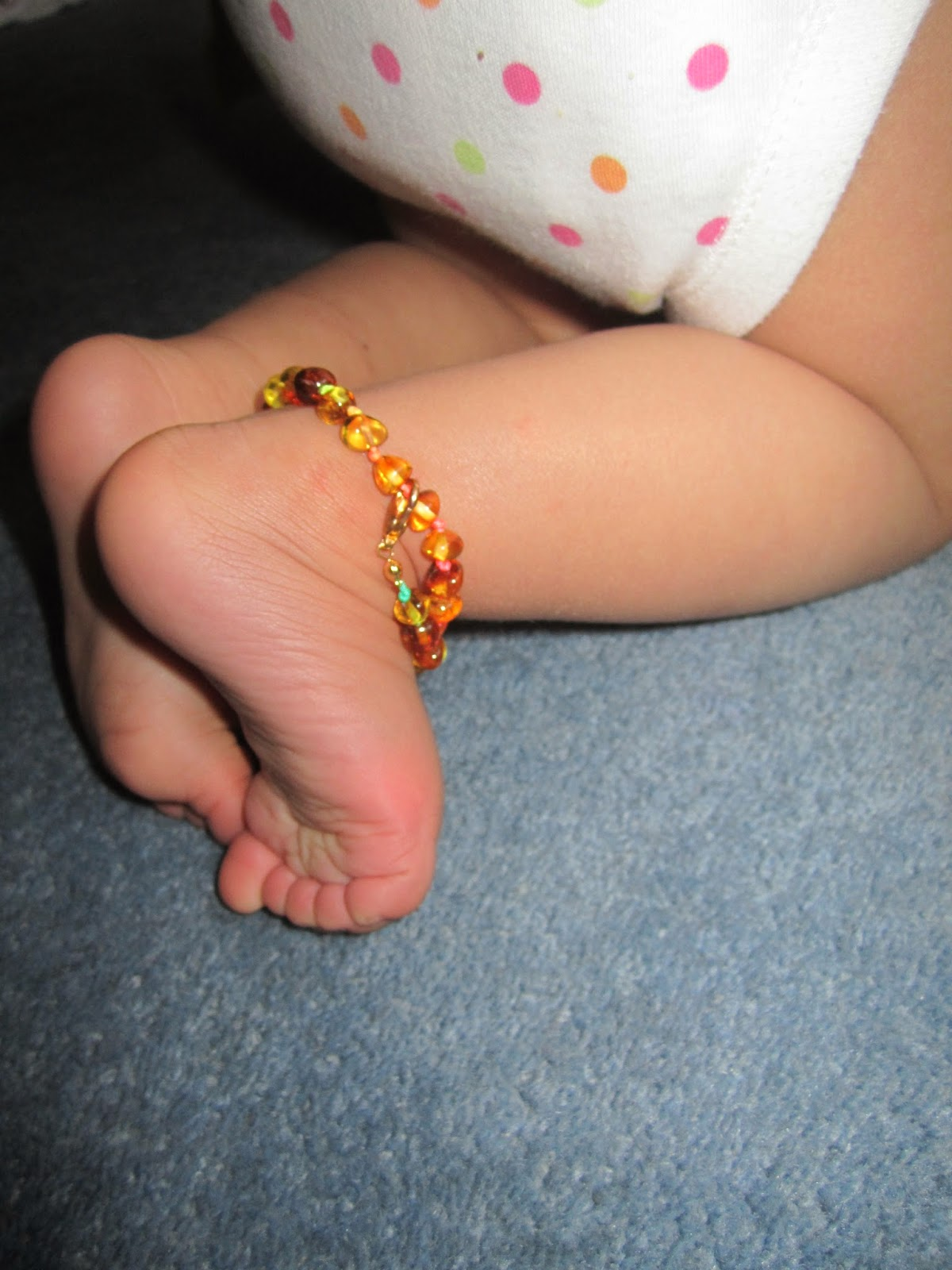 Baby wearing amber anklet