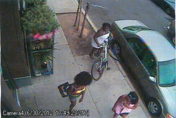 And here's one of the Bikini Bandits simply helping herself to a bike:
