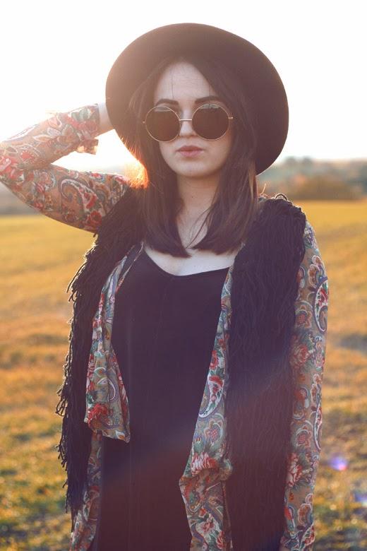 hippy, uk fashion blogger, uk fashion style, zerouv, oversized sunglasses, 70's sunglasses, knitted vest, tassel vest, tassel gilet, fedora, hippie, retro, retro pattern, autumn look, fall look, sunset photo, layering, autumn layering, missguided vellvet swing dress, oasap, cut out boots, office boots