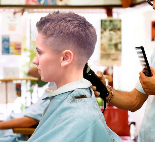 Woman Getting Haircut in Barber Chair