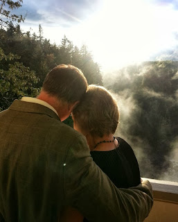 The bride and groom enjoy the sun after their ceremony - Ceremony celebrated by Patricia Stimac, Seattle Elope