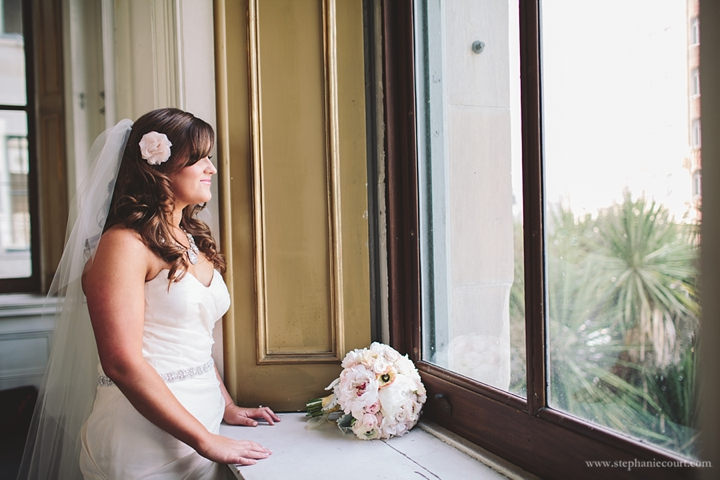"""bride watching guests arrive at old mint in san francisco"""